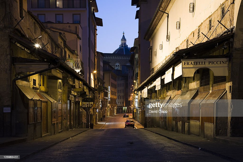 On the Ponte Vecchio bridge at dawn showing shutters on jewellery shops, Florence, Italy : Stock Photo