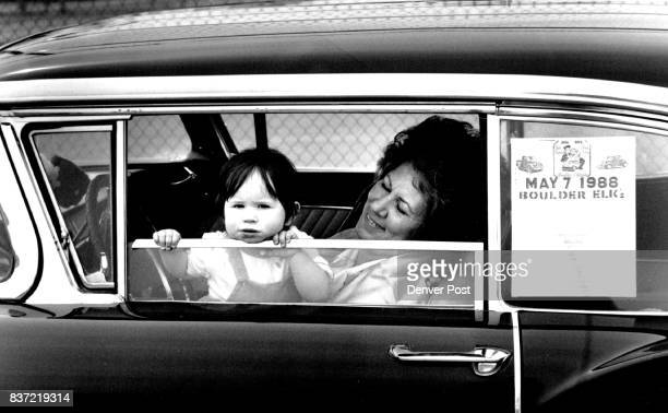 MAY 1 1988 on the right is Darline Schossow the little girl is her grand daughter Tonia Martin who is one year old they are in a 1958 Ford outside of...