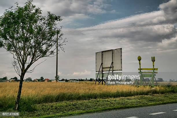 On the Road from Wroclaw to Warsaw, billboards on rural polish countryside