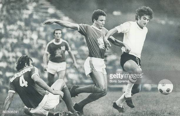 On the run Toronto MetrosCroatia defenceman Phil Blaskovic takes a tumble leaving a teammate and a player from Italy's touring Roma club in pursuit...