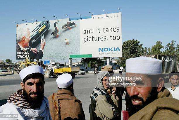 On the rural outskirts of Islamabad Pakistan a giant Nokia cell phone advertisement is a landmark along the historic Grand Trunk Highway March 4 2004