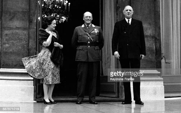 On the steps of the Elysee palace during an official visit Yvonne de Gaulle King Olav V and General de Gaulle on September 26 1962 in Paris France