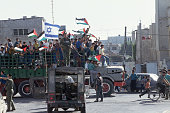 On the streets of Gaza Israeli soldiers try to maintain order during the happy chaos of tens of thousands of Palestinians celebrating the signing of...