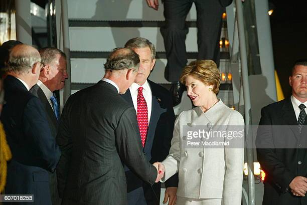 On the tarmac at Heathrow Airport Prince Charles of Wales greets US First Lady Laura Bush and American President George W Bush as they deplane from...