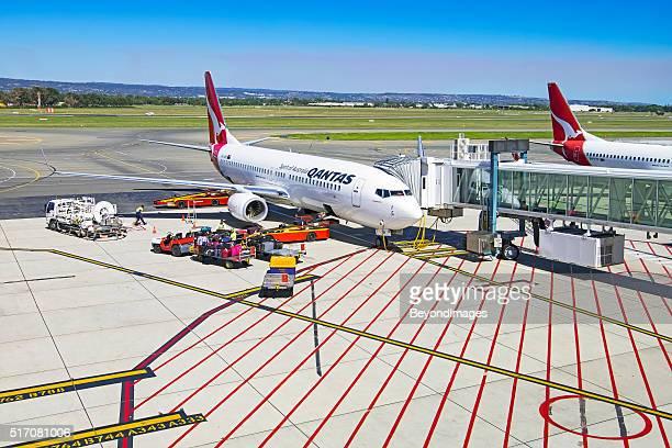 On the tarmac, Qantas aircraft being prepared for next flight