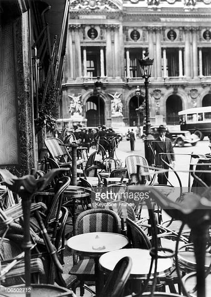 On The Terrace Of Cafe De La Paix Place De L'Opera In Paris Chairs And Tables Are One On The Others In A Mess Following The Strike Of Waiters On June...