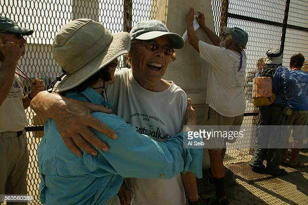 On the United States side of the monument marking the border with Mexico at Border Field State Park Coastwalker Helene Baouendi 67–years–old from San...