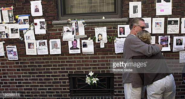 On the wall of a building near the Armory 26th St and Lexington Peter Cullinan from Longmeadow Mass hugs his daughter Tricia Cullinan who just got a...