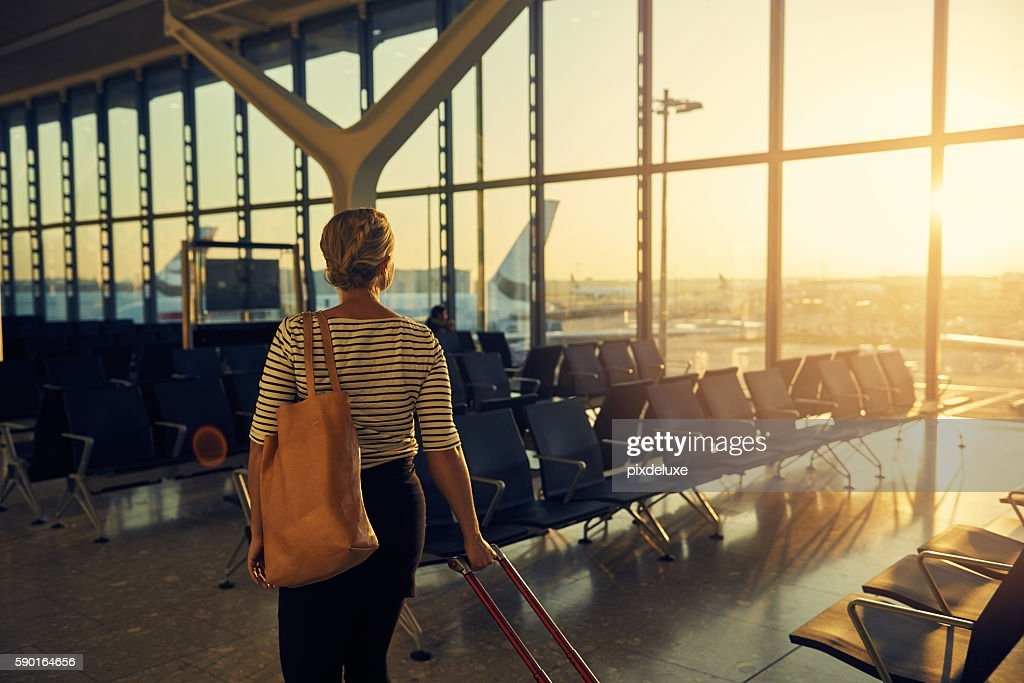 On the way to her gate : Stock Photo
