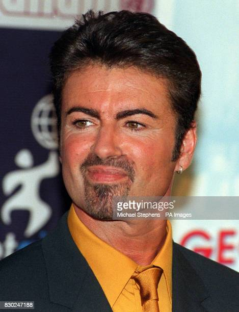 On this day in 1963 pop singer George Michael was born in London Pop singer George Michael smiles during a press conference in London where he...