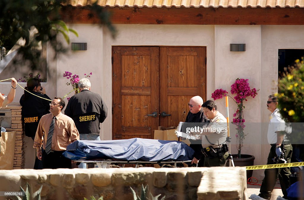 On Thursday afternoon officials working for the Ventura County Medical Examiners Office remove the bodies of Brock Husted and his pregnant wife...