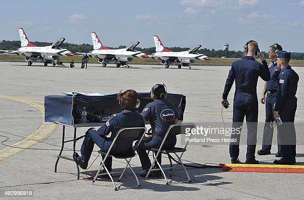 On Thursday August 23 2012 members of the Air Force communication team help the pilots and supporting staff get ready for a trial run of the air show...