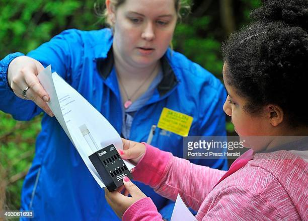 On Thursday May 23 Lizz Eyler an intern from Husson University helps Gianna Bent read test for acidity as the Portland Water District holds a...