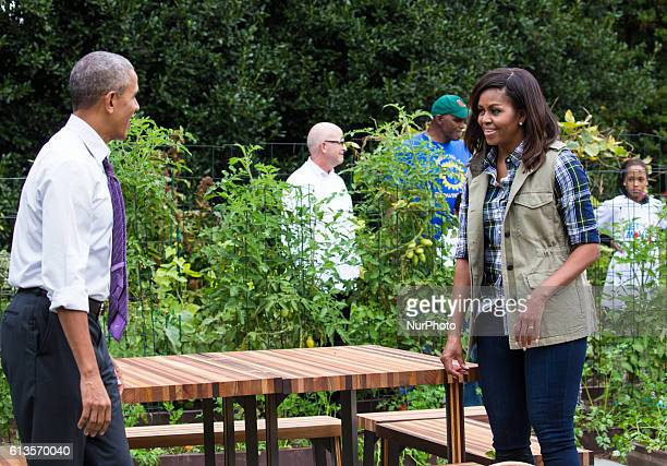 On Thursday Oct 6 President Barack Obama and First Lady Michelle Obama check out the custom picnic table and benches made from wood that has...