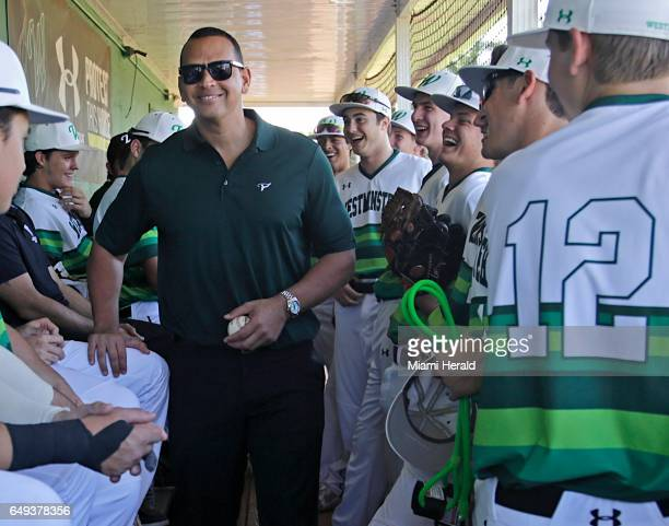 On Tuesday March 7 Alex Rodriguez center talks to players prior to throwing the first pitch as Westminster Christian high school celebrates the 25th...