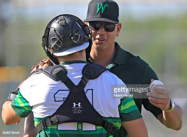 On Tuesday March 7 Alex Rodriguez thanks the catcher after throwing the ceremonial first pitch as Westminster Christian high school celebrates the...