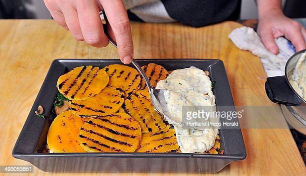 On Tuesday October 8 Cooking Instructor Christine Burns Rudalevige spoons a ricotta cheese and herb mixture over the sliced butternut squash as she...