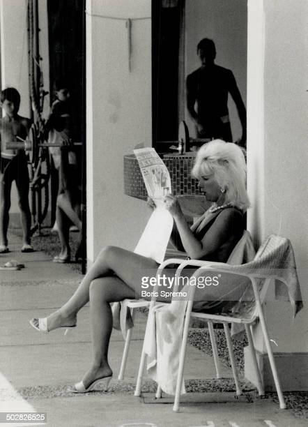 On vacation in Yalta woman catches up on the news