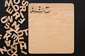 ABC on wooden board, copy space. Back to school concept