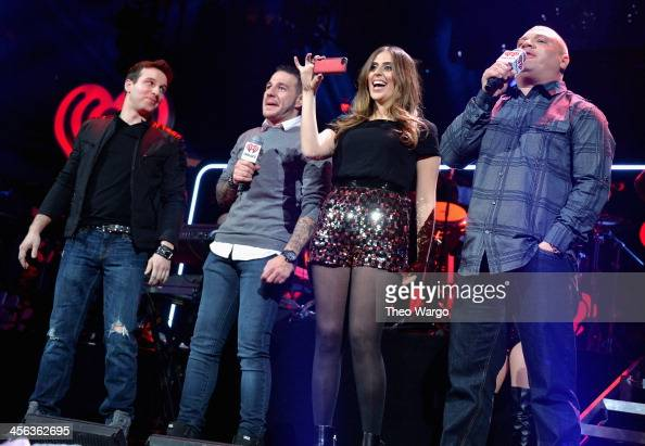 OnAir personalities Phill Kross Mo' Bounce Shelley Rome and Greg T speak onstage during Z100's Jingle Ball 2013 presented by Aeropostale at Madison...