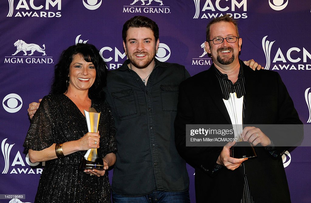 On-Air Personality of the Year for Large Market Winners Dave Chelsie 'Chelsie' Shinkle and 'Big Dave' Chandler accept award from Singer Chris Young (C) onstage during ACM Radio Awards Reception at the MGM Grand Hotel/Casino on March 31, 2012 in Las Vegas, Nevada.