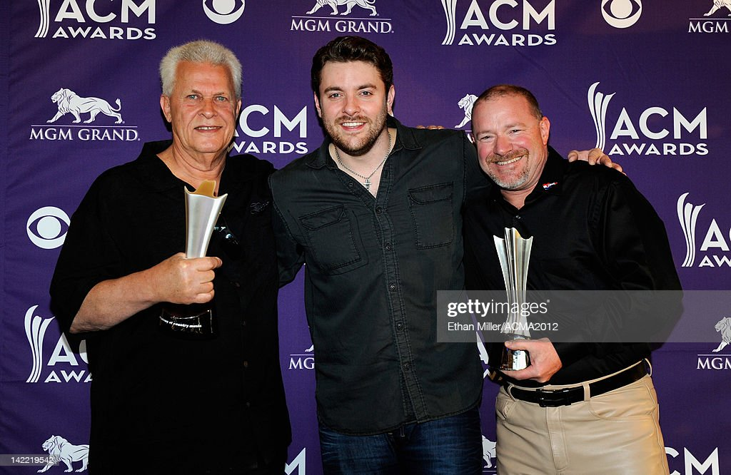 On-Air Personality of the Year for Medium Market Winners KUZZ-AM/FM Steve Gradowitz and Geoff Emery accept award from Singer Chris Young (C) onstage during ACM Radio Awards Reception at the MGM Grand Hotel/Casino on March 31, 2012 in Las Vegas, Nevada.
