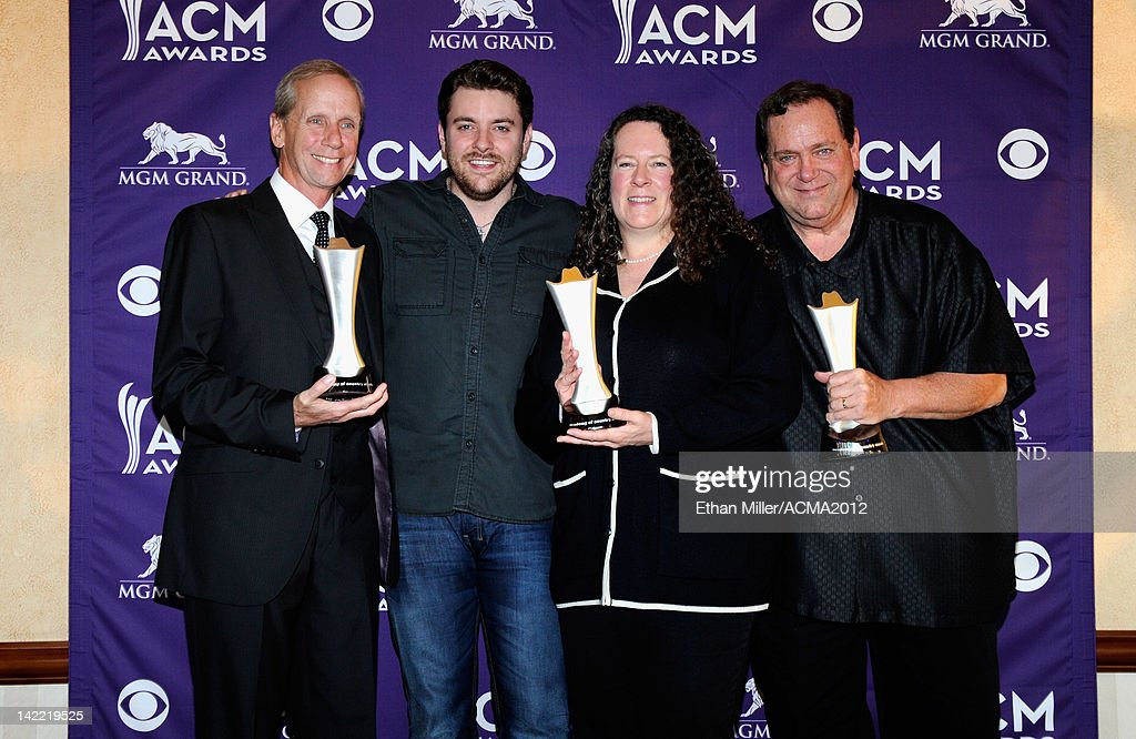 On-Air Personality of the Year for Small Market Winners KKNU-FM Tim Fox (L), Tracy Berry and Bill Barrett (R) accept award from Singer Chris Young (2ndL) onstage during ACM Radio Awards Reception at the MGM Grand Hotel/Casino on March 31, 2012 in Las Vegas, Nevada.