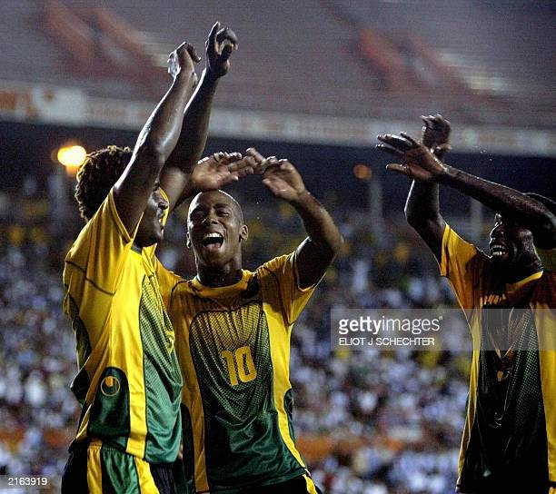 Onandi Lowe of Jamaica celebrates with teammates Darren Byfield and Theodore Whitmore after his first period goal against Guatemala in the Gold Cup...