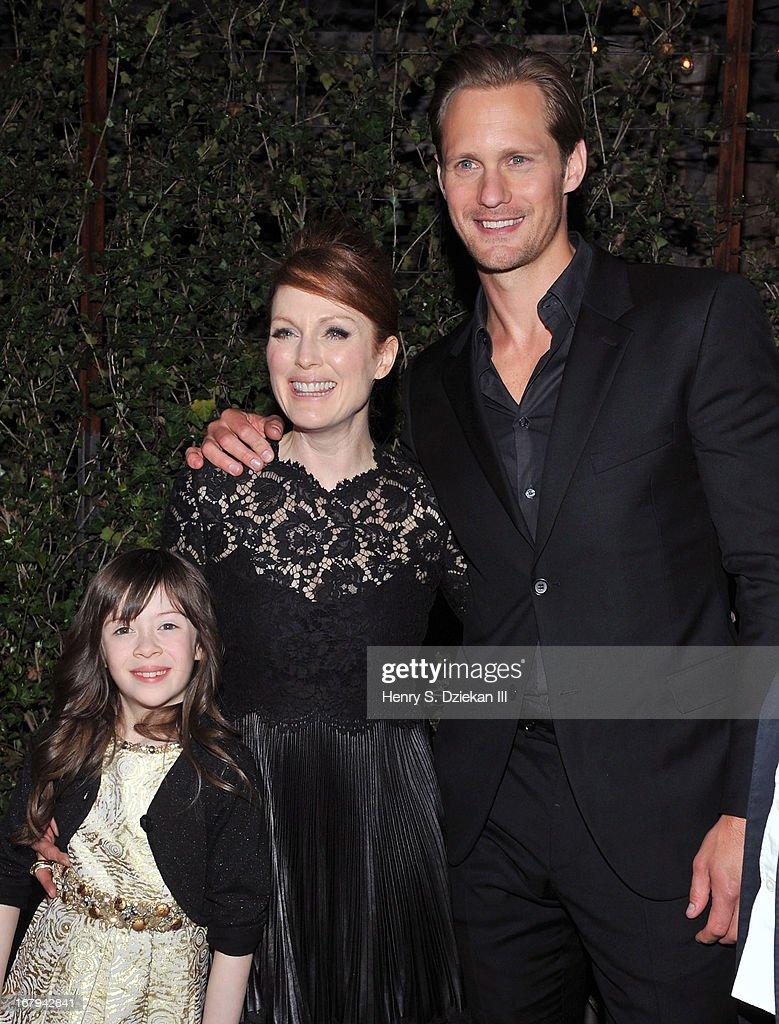 Onata Aprile, <a gi-track='captionPersonalityLinkClicked' href=/galleries/search?phrase=Julianne+Moore&family=editorial&specificpeople=171555 ng-click='$event.stopPropagation()'>Julianne Moore</a> and Alexander Skarsgard attend The Cinema Society With Tod's & GQ screening of Millennium Entertainment's 'What Maisie Knew' after party at Gallow Green at the McKittrick Hotel on May 2, 2013 in New York City.