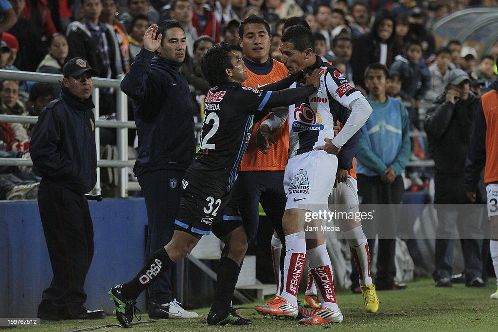Onay Pineda (L) of Queretaro and Oscar Rojas (R) of Pachuca react during a match between Pachuca and Queretaro as part of the Clausura 2013 Liga MX at Hidalgo Stadium on January 19, 2013 in Pachuca, Mexico.