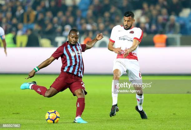 Onazi of Trabzonspor in action against Deniz Kadah of Antalyaspor during a Turkish Super Lig match between Trabzonspor and Antalyaspor at Medical...