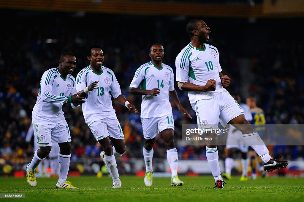 Onazi Ogenyi (R) of Nigeria celebrates after scoring his team's first goal during a friendly match between Catalonia and Nigeria at Cornella-El Prat Stadium on January 2, 2013 in Barcelona, Spain.