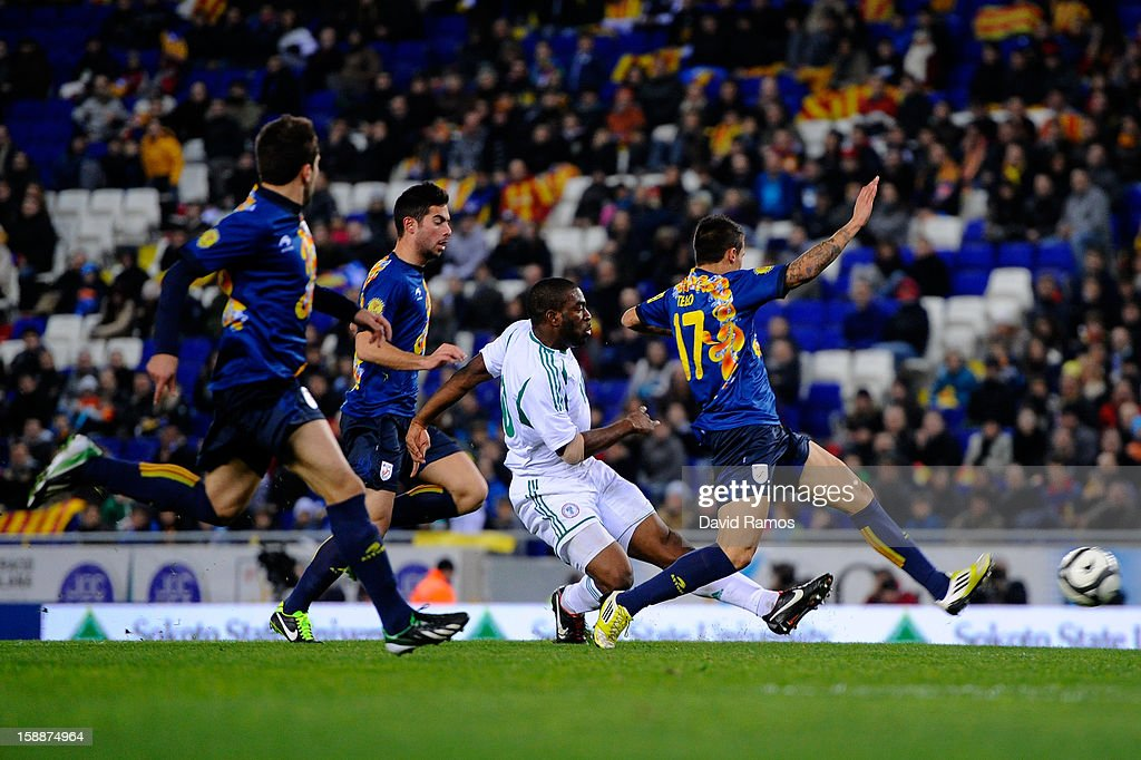 Onazi Ogenyi (C) of Nigeria scores his team's first goal during a friendly match between Catalonia and Nigeria at Cornella-El Prat Stadium on January 2, 2013 in Barcelona, Spain.