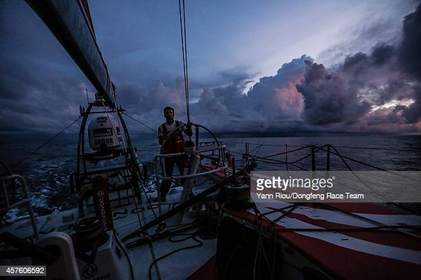 Onboard Dongfeng Race Team Eric Peron at the helm during a difficult night with lots of clouds on October 20 2014 during Leg 1 between Alicante Spain...