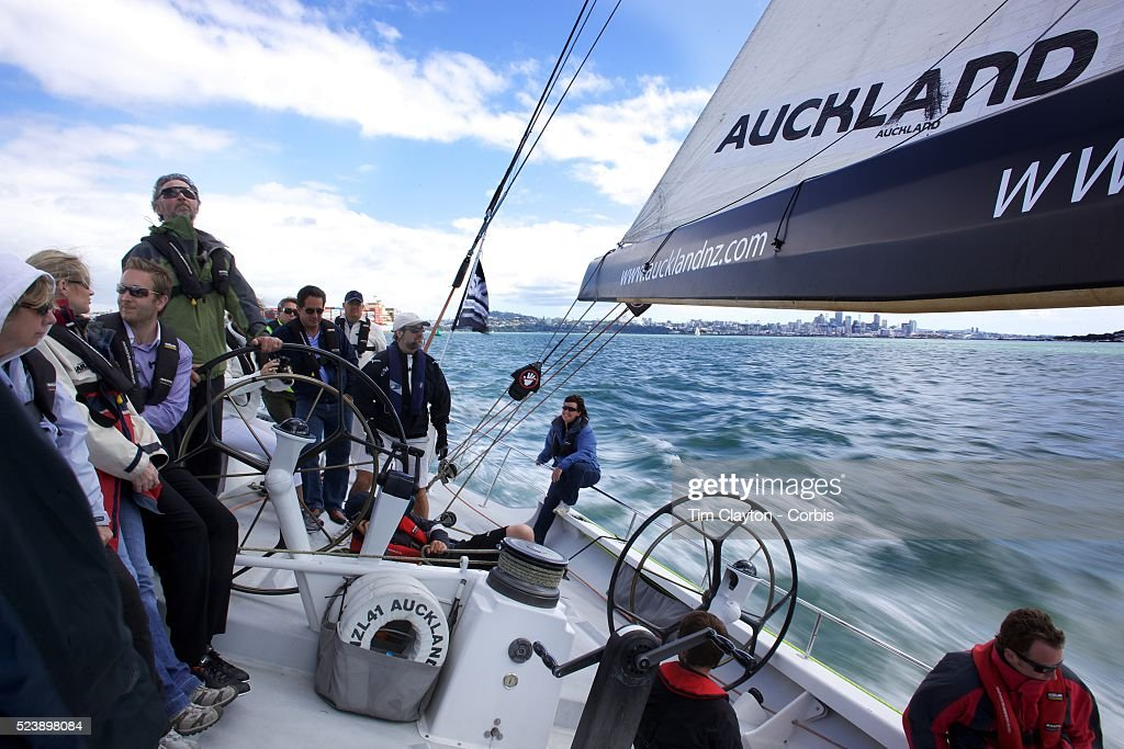 Onboard sailing on the America's Cup Yacht NZL41 The yacht sails with tourist daily on Auckland Harbour from the Viaduct Basin Auckland New Zealand...