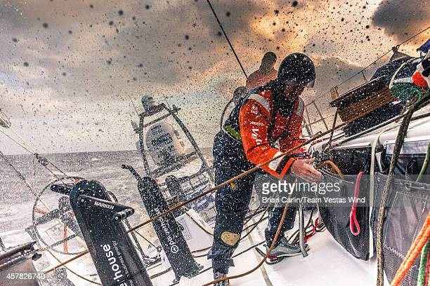 Onboard Team Vestas Wind Nicolai Sehested cleans the cockpit up as waves break overduring Leg 1 between Alicante Spain and Cape Town South Africa The...