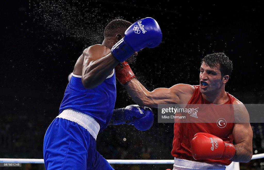 Onder Sipal of Turkey fights against Benny Muziyo Muziyo of Zambia in their Mens Middleweight 75kg bout on Day 4 of the Rio 2016 Olympic Games at the...