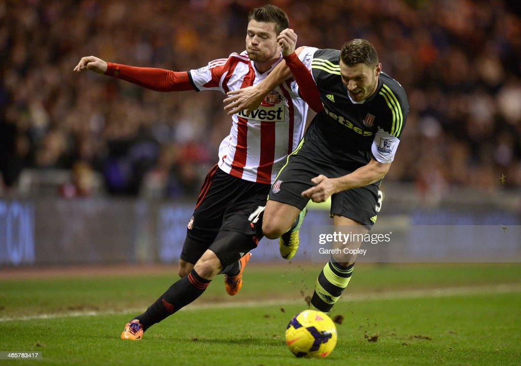 Ondrej Celustka of Sunderland is tackled by Erik Pieters of Stoke City during the Premier League match between Sunderland and Stoke City at Stadium of Light on January 29, 2014 in Sunderland, England.