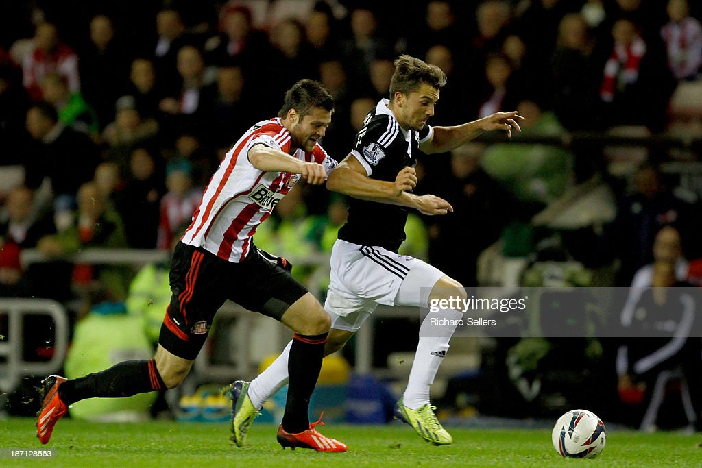 Ondrej Celustka (L) of Sunderland vies with Jay Rodriguez of Southampton during the Capital One Cup fourth Round match between Sunderland and Southampton at Stadium of Light on November 06, 2013 in Sunderland, England.