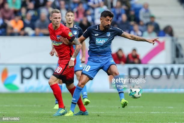 Ondrej Duda of Berlin and Kerem Demirbay of Hoffenheim battle for the ball during the Bundesliga match between TSG 1899 Hoffenheim and Hertha BSC at...