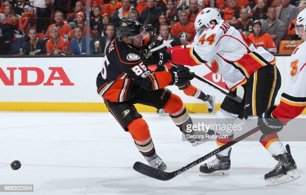 Ondrej Kase of the Anaheim Ducks battles for the puck against Matt Bartkowski of the Calgary Flames in Game One of the Western Conference First Round...