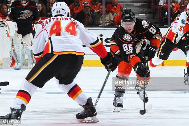 Ondrej Kase of the Anaheim Ducks skates with the puck against Matt Bartkowski of the Calgary Flames in Game One of the Western Conference First Round...