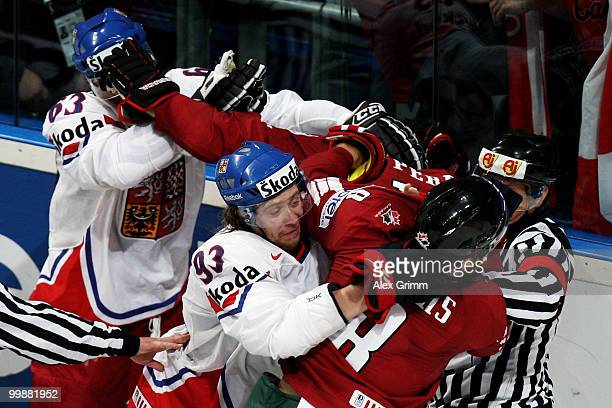 Ondrej Nemec and Jakub Voracek of Czech Republic fight with Corey Perry and Brent Burns of Canada during the IIHF World Championship group F...