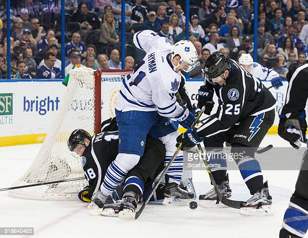 Ondrej Palat and Matt Carle of the Tampa Bay Lightning skates against Zach Hyman of the Toronto Maple Leafs during the second period at the Amalie...