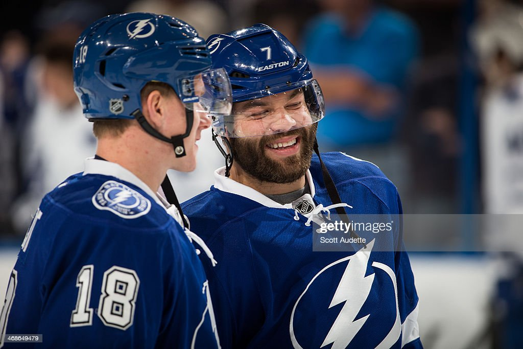 Ondrej Palat #18 and <a gi-track='captionPersonalityLinkClicked' href=/galleries/search?phrase=Radko+Gudas&family=editorial&specificpeople=5648763 ng-click='$event.stopPropagation()'>Radko Gudas</a> #7 of the Tampa Bay Lightning joke around during the pregame warm ups prior to the game against the Toronto Maple Leafs at the Tampa Bay Times Forum on February 6, 2014 in Tampa, Florida.
