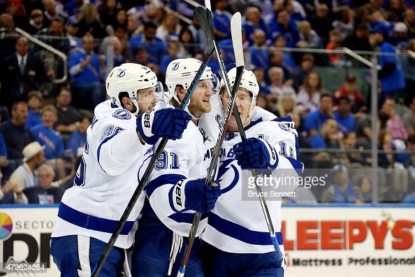 Ondrej Palat celebrates with Steven Stamkos and Nikita Kucherov of the Tampa Bay Lightning after scoring a goal in the third period against the New...