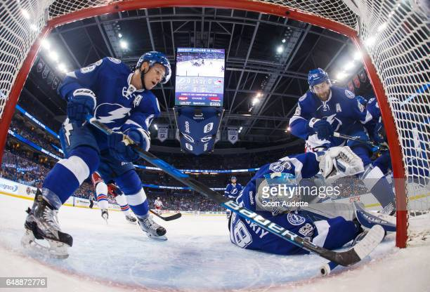 Ondrej Palat goalie Andrei Vasilevskiy and Braydon Coburn of the Tampa Bay Lightning keep the puck from crossing the line for a goal against the New...