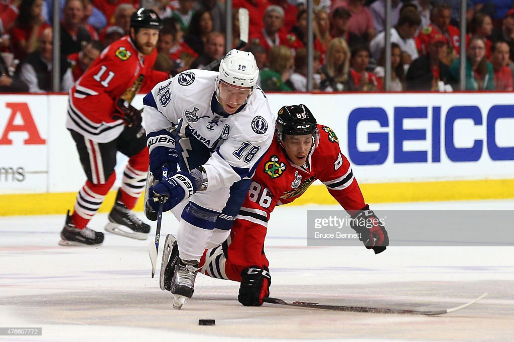 Ondrej Palat #18 of the Tampa Bay Lightning and Teuvo Teravainen #86 of the Chicago Blackhawks battle for the puck in the first period during Game Four of the 2015 NHL Stanley Cup Final at the United Center on June 10, 2015 in Chicago, Illinois.