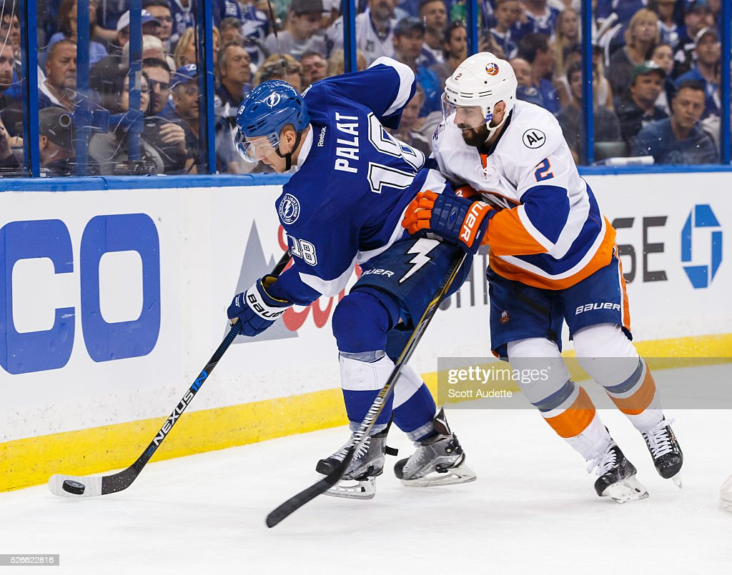 Ondrej Palat #18 of the Tampa Bay Lightning battles against <a gi-track='captionPersonalityLinkClicked' href=/galleries/search?phrase=Nick+Leddy&family=editorial&specificpeople=5894600 ng-click='$event.stopPropagation()'>Nick Leddy</a> #2 of the New York Islanders during the third period of Game Two of the Eastern Conference Second Round in the 2016 NHL Stanley Cup Playoffs at the Amalie Arena on April 30, 2016 in Tampa, Florida.