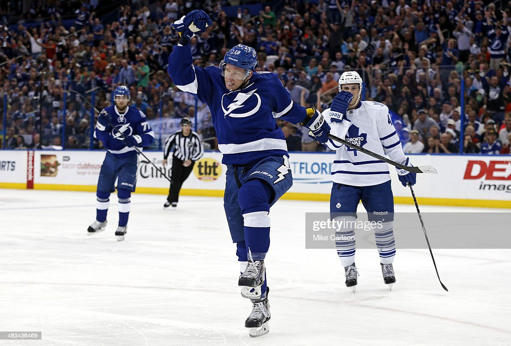 Ondrej Palat #18 of the Tampa Bay Lightning celebrates his goal in front of Tyler Bozak #42 of the Toronto Maple Leafs at the Tampa Bay Times Forum on April 8, 2014 in Tampa, Florida.